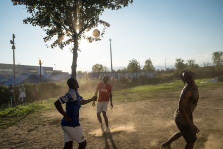 Guests play soccer at the Red Cross camp in Settimo Torinese (Italy).