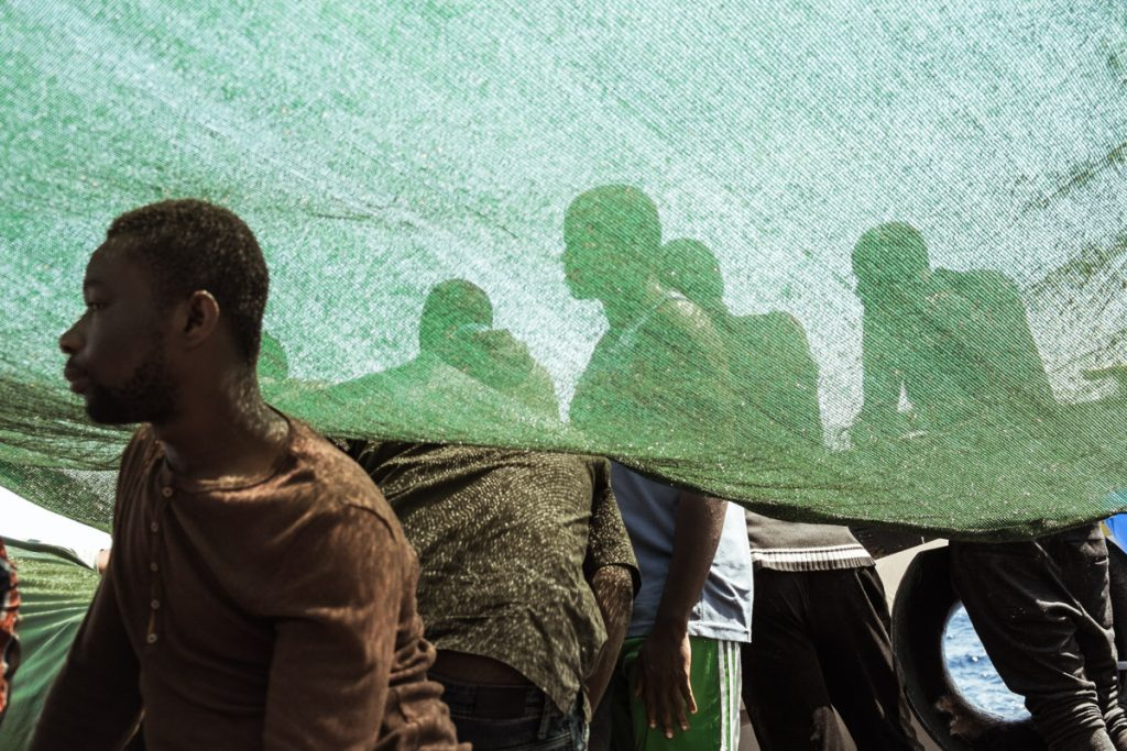 Migrants on board a humanitarian rescue vessel in the Mediterranean