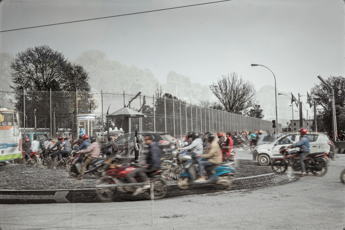 An image composed by two superimposed photographs showing the same Kathmandu crossing in 1975 and in 2018.