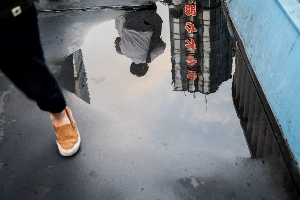 Street scene in Tokyo. Reflection.
